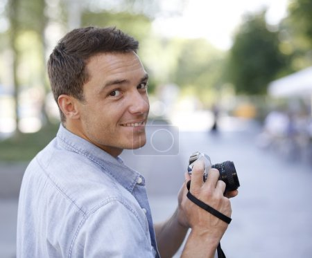 Man photographing with vintage camera