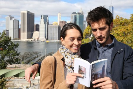 Tourists reading New York city guide