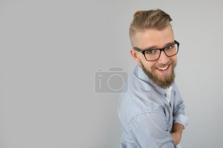 Photo for Portrait of smiling guy looking at camera - Royalty Free Image