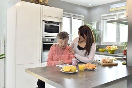 Elderly woman doing crossword