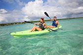 Couple canoeing in lagoon