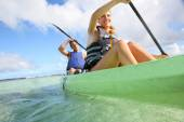 Couple canoeing in sea