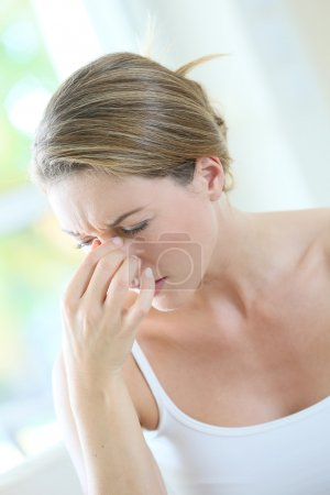 Woman suffering migraine
