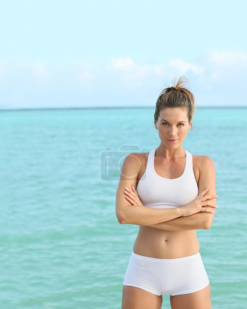 Fitness girl with crossed arms