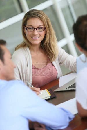 Financial adviser with couple in office