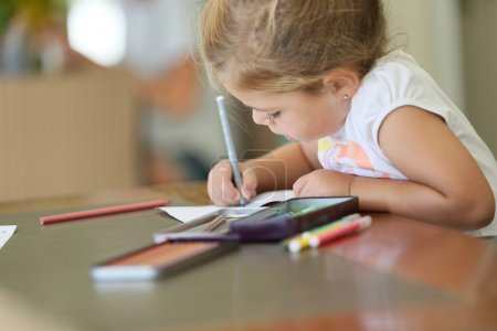 Photo for Cute little girl making drawings - Royalty Free Image
