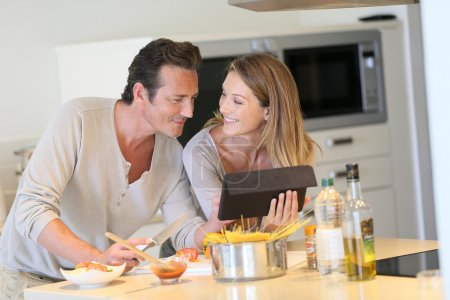 Couple looking at recipe on tablet