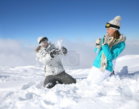 Couple doing snowballs fight