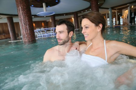 Couple in spa center jacuzzi