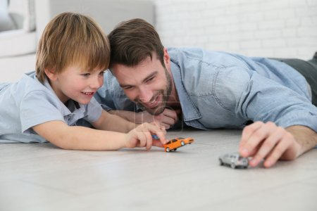 Daddy with boy playing with cars