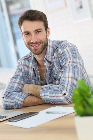 Photo for Portrait of smiling home-office worker - Royalty Free Image