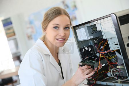 Girl fixing computer hard drive