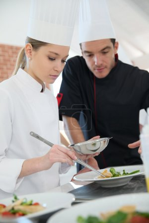 Girl in cooking class with chef