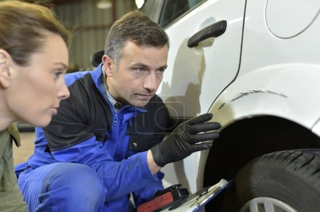 Mechanic with insurance adjuster