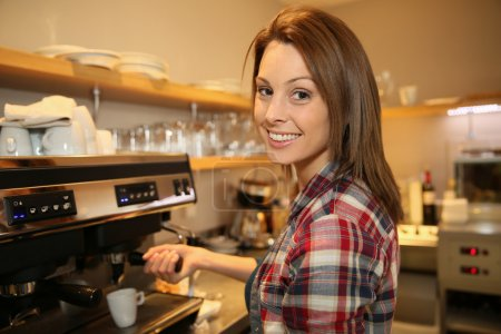 Photo for Female coffeeshop keeper preparing expresso - Royalty Free Image