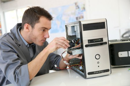 Photo for Male technician fixing computer hardware - Royalty Free Image