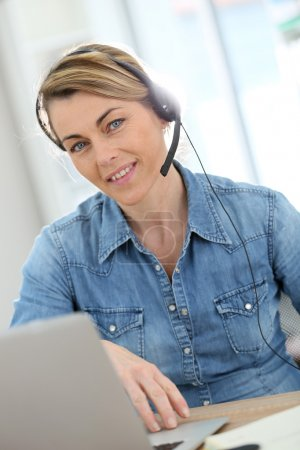Photo for Active mature woman teleworking from home - Royalty Free Image