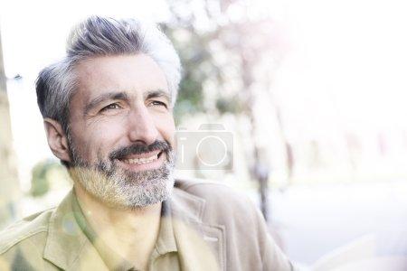 Man sitting on public bench
