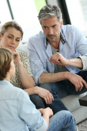 Parents having talk with boy