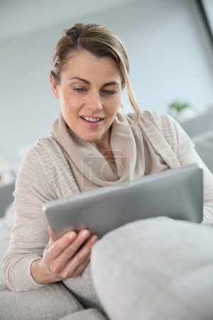 Woman websurfing with tablet