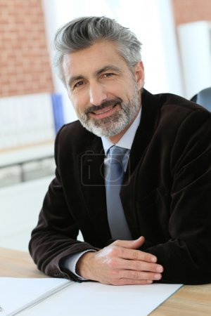 Photo pour Portrait of confident mature notary in office - image libre de droit