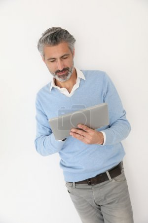 Man websurfing with tablet