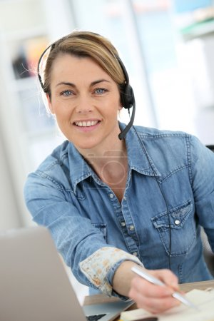 Photo for Active woman teleworking from home - Royalty Free Image