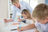 Teacher helping kids