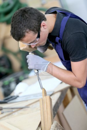 apprentice in carpentry working
