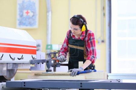 carpenter using  sawing machine