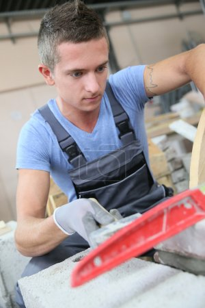 Man in masonry professional school