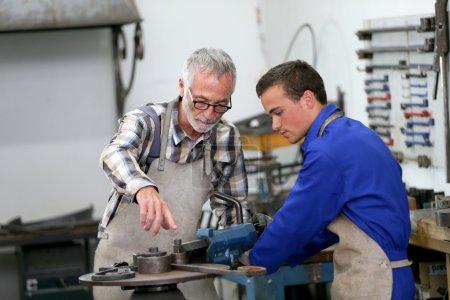 man in ironworks training