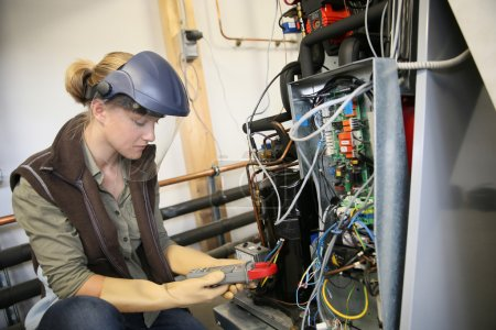 woman controlling electrical intensity
