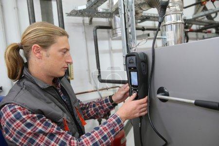 Technician checking heat pump intensity