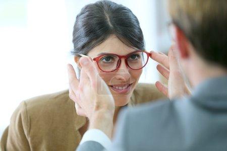 Optician testing new eyeglasses