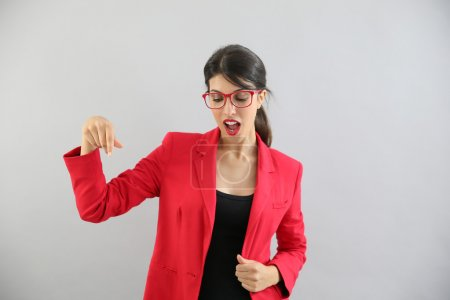 girl with red jacket on  pointing