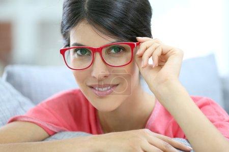 Brunette girl wearing red eyeglasses
