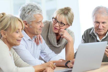 retired senior people using laptop