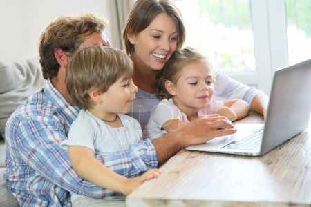 Parents with kids  using laptop