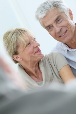 happy senior couple talking