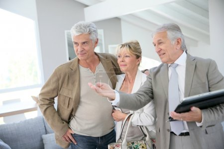 real-estate agent visiting house for sale