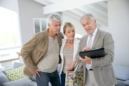 Senior couple with real-estate agent