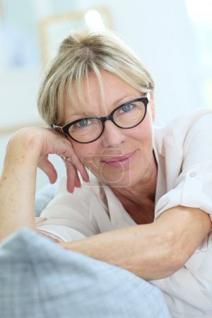 senior woman with eyeglasses on