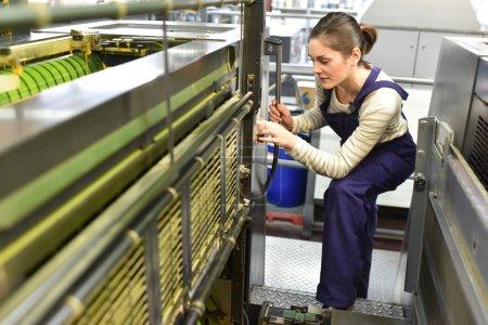 Woman  preparing machine