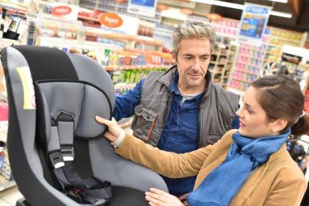 seller helping  to choose child seat