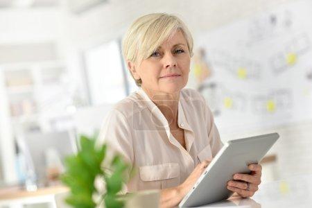 Senior businesswoman working on  tablet