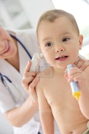 Pediatrician taking  temperature