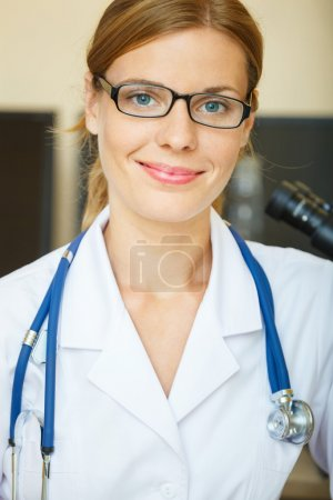 Portrait of young doctor in a laboratory looking at camera