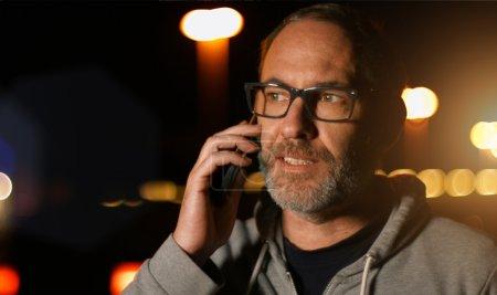 Handsome man speaking on smartphone