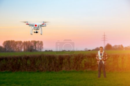 Photo for Flying drone with camera on the sky background - Royalty Free Image